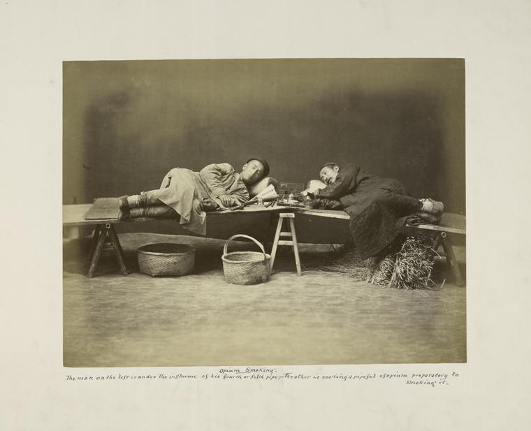 Opium Smoking, The Man on the Left is Under the Influence of His Fourth or Fifth Pipe, The Other is Cooking a Pipeful of Opium Preparatory to Smoking it